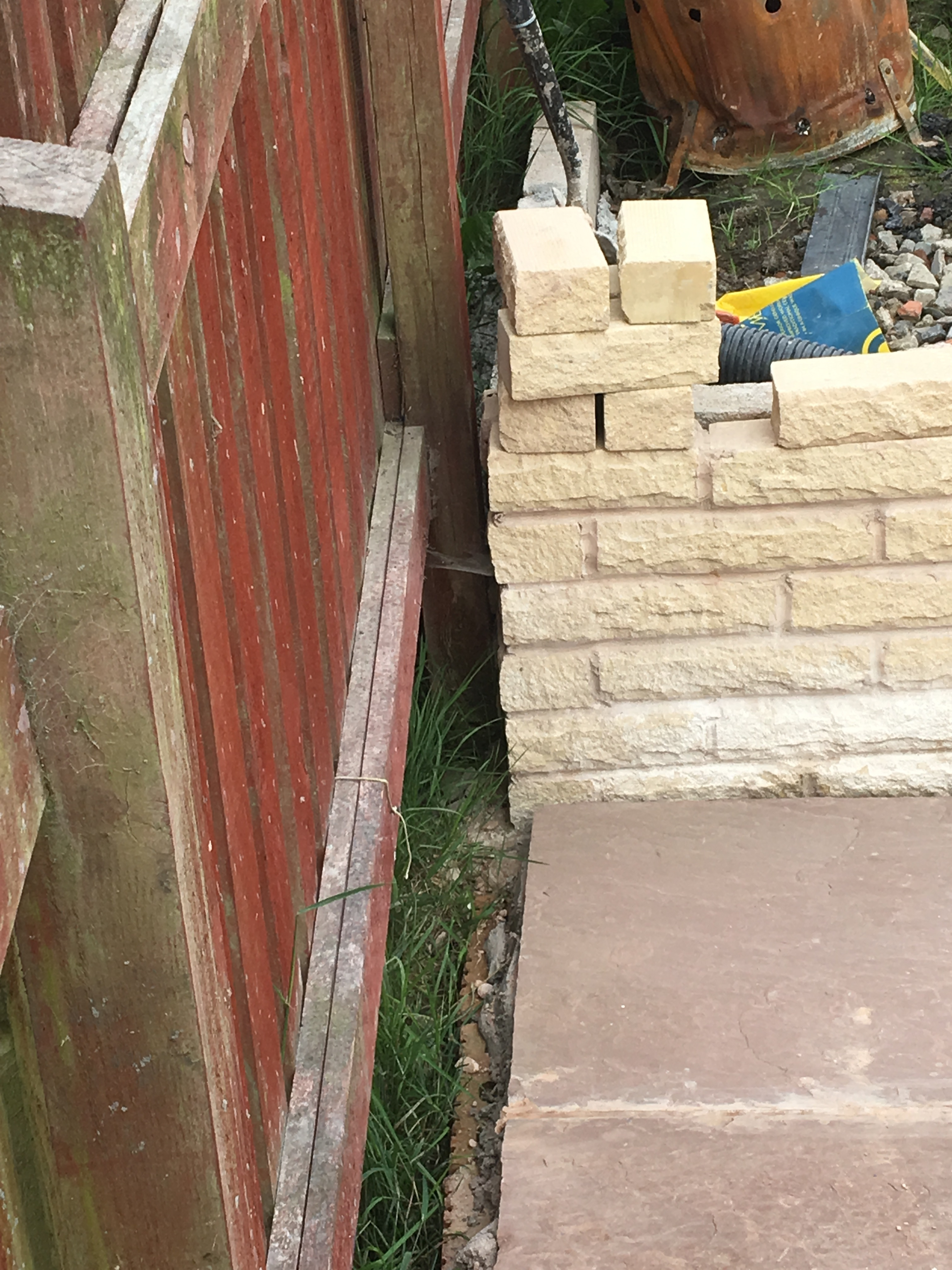 Retaining wall to new level lawn
